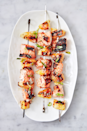 """<p><a href=""""https://www.delish.com/uk/cooking/recipes/a29771277/pineapple-salmon-sheet-pan-dinner-recipe/"""" rel=""""nofollow noopener"""" target=""""_blank"""" data-ylk=""""slk:Pineapple and salmon"""" class=""""link rapid-noclick-resp"""">Pineapple and salmon</a> are a match made in heaven. Smoky, sweet, and just a little spicy, these skewers are a major crowd-pleaser. Make them for your next barbecue, and watch them disappear.</p><p>Get the <a href=""""https://www.delish.com/uk/cooking/recipes/a32399432/pineapple-salmon-skewers-recipe/"""" rel=""""nofollow noopener"""" target=""""_blank"""" data-ylk=""""slk:Pineapple Salmon Skewers"""" class=""""link rapid-noclick-resp"""">Pineapple Salmon Skewers</a> recipe. </p>"""