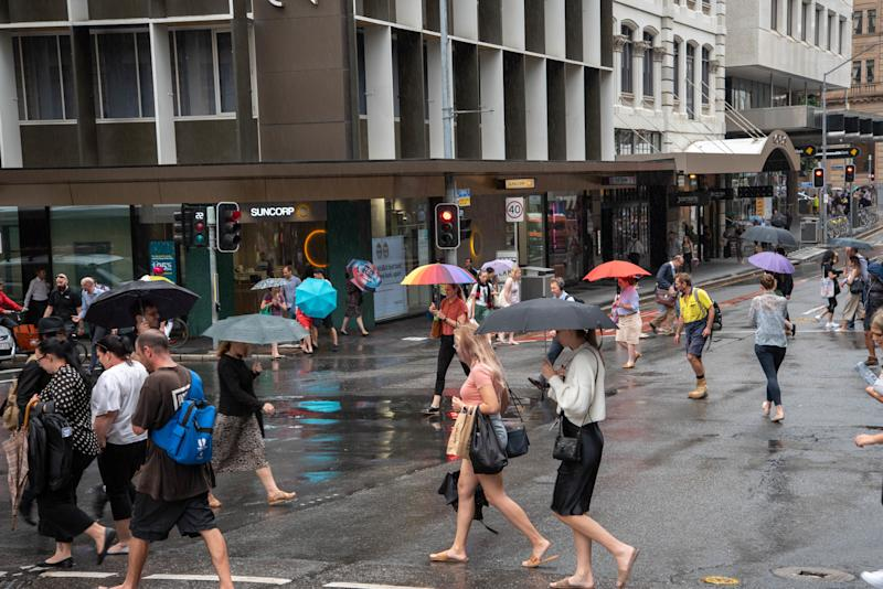 BRISBANE, AUSTRALIA - 2020/02/12: Pedestrians shelter from the rain beneath an umbrella on a rainy day in Brisbane. Severe storm hits South East Queensland and Brisbane CBD causing traffic chaos and floods. (Photo by Florent Rols/SOPA Images/LightRocket via Getty Images)