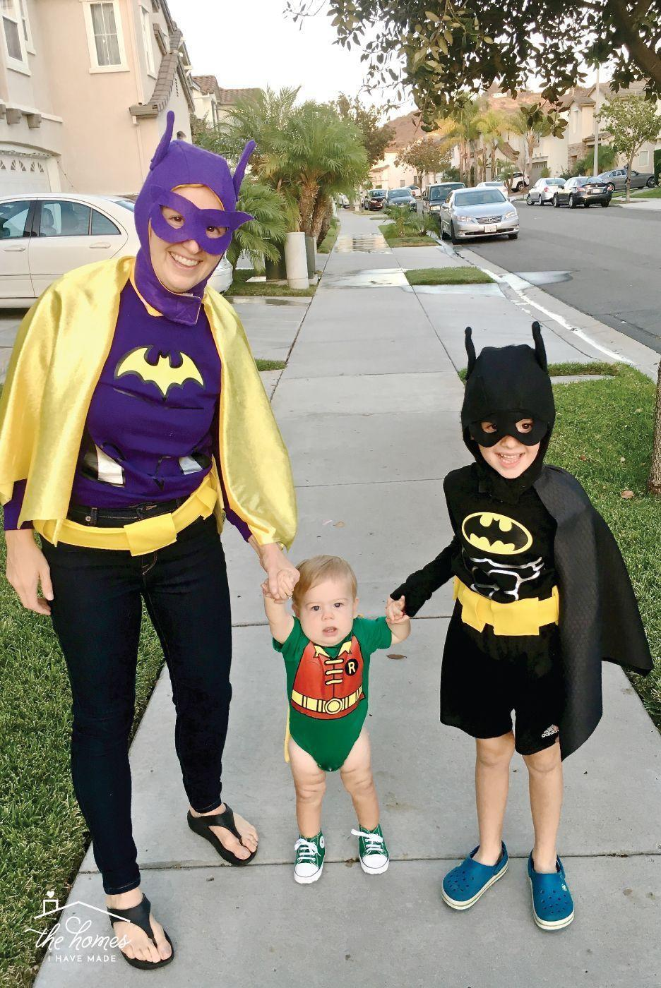 """<p>Save the day in these classic superhero-inspired outfits. This idea works well for all ages, but if you can recruit a Robin as tiny as this one, you're in for an even more adorable ensemble. </p><p><strong>Get the tutorial at <a href=""""https://thehomesihavemade.com/2018/10/lego-batman-costume-with-batgirl-robin-too/"""" rel=""""nofollow noopener"""" target=""""_blank"""" data-ylk=""""slk:The Homes I Have Made"""" class=""""link rapid-noclick-resp"""">The Homes I Have Made</a>.</strong></p><p><a class=""""link rapid-noclick-resp"""" href=""""https://go.redirectingat.com?id=74968X1596630&url=https%3A%2F%2Fwww.walmart.com%2Fsearch%2F%3Fquery%3Diron%2Bon%2Bvinyl&sref=https%3A%2F%2Fwww.thepioneerwoman.com%2Fhome-lifestyle%2Fcrafts-diy%2Fg37066817%2Fhalloween-costumes-for-3-people%2F"""" rel=""""nofollow noopener"""" target=""""_blank"""" data-ylk=""""slk:SHOP IRON-ON VINYL"""">SHOP IRON-ON VINYL</a></p>"""