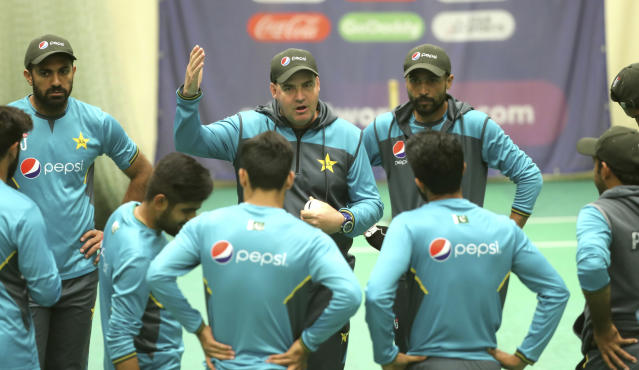 Pakistan's coach Mickey Arthur, center, speaks to players during an indoor training session ahead of their Cricket World Cup match against India at Old Trafford in Manchester, England, Saturday, June 15, 2019. (AP Photo/Aijaz Rahi)