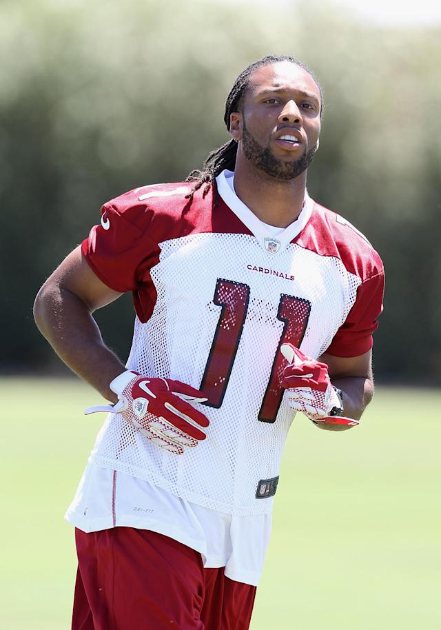 TEMPE, AZ - JUNE 13: Wide receiver Larry Fitzgerald #11 of the Arizona Cardinals practices in the minicamp at the team's training center facility on June 13, 2012 in Tempe, Arizona. (Photo by Christian Petersen/Getty Images)