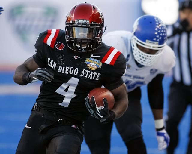 San Diego State running back Adam Muema (4) runs the ball past Buffalo linebacker Khalil Mack during the first half of the Famous Idaho Potato Bowl NCAA college football game in Boise, Idaho, on Saturday, Dec. 21, 2013. San Diego State won 49-24. (AP Photo/Otto Kitsinger)
