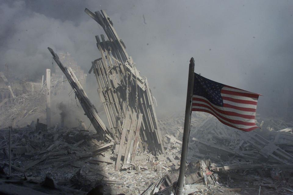 <p>Am American flag flies near the base of the destroyed World Trade Center. (Reuters)</p>