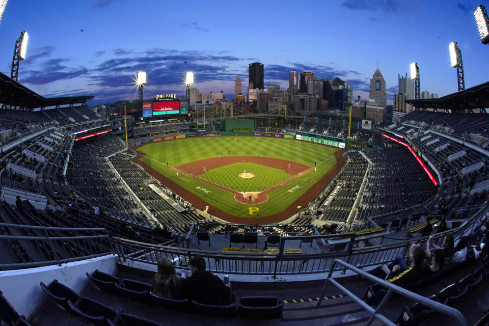 The sun sets during a baseball game between the Pittsburgh Pirates and the San Francisco Giants in Pittsburgh, Thursday, May 13, 2021.(AP Photo/Gene J. Puskar)