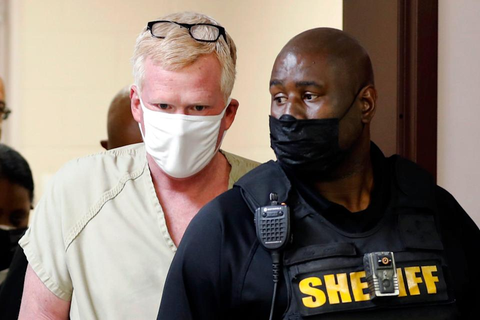 Alex Murdaugh walks into his bond hearing Thursday, Sept. 16, 2021, in Varnville, S.C. Six investigations are underway, over the June 7 killings of his wife and son, allegations of stolen money, claims of coverups and a Sept. 4 shooting in which a bullet grazed Murdaugh's head on a lonely highway. Police said he tried to arrange his own death and make sure a $10 million life insurance policy would pay off for his surviving son. (AP Photo/Mic Smith)