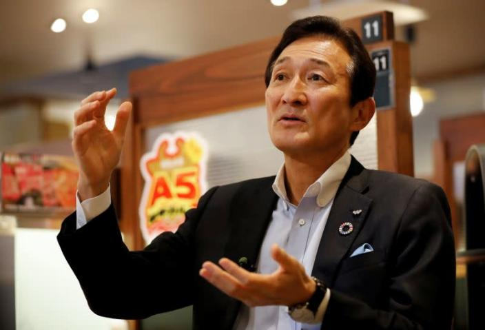 Miki Watanabe, Chairman and CEO of Watami Co. speaks during an interview with Reuters at the company's yakiniku barbecue restaurant named 'Yakiniku no Watami', in Tokyo
