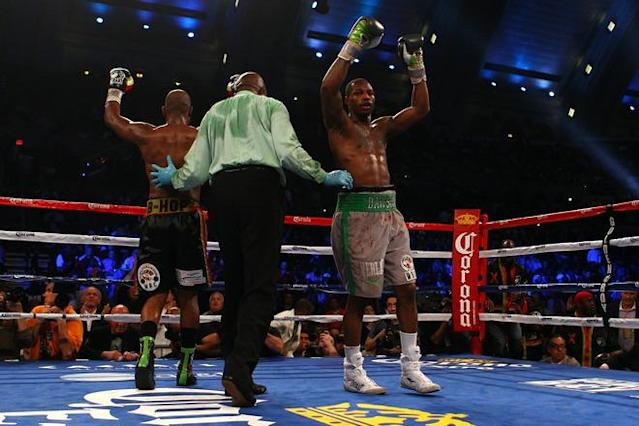 ATLANTIC CITY, NJ - APRIL 28: Both Chad Dawson (grey trunks) and Bernard Hopkins (black trunks) react at the end of the 12th round during their WBC & Ring Magazine Light Heavyweight Title fight at Boardwalk Hall Arena on April 28, 2012 in Atlantic City, New Jersey. Dawson was declared the winner by decision. (Photo by Al Bello/Getty Images)