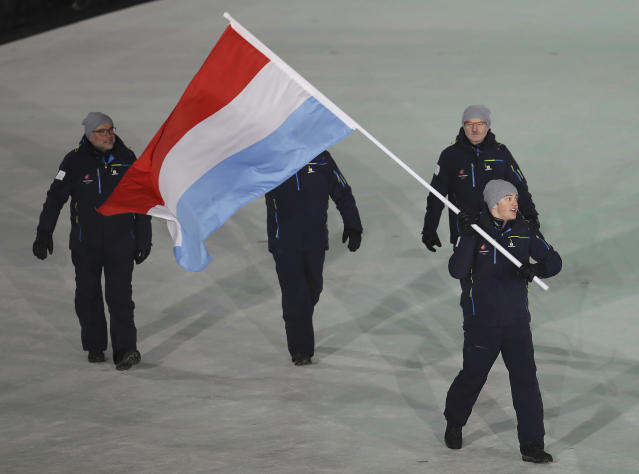 <p>Matthieu Osch carries the flag of Luxembourg during the opening ceremony of the 2018 Winter Olympics in Pyeongchang, South Korea, Friday, Feb. 9, 2018. (AP Photo/Michael Sohn) </p>