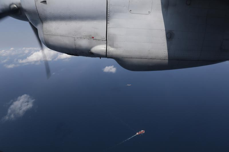 """Ships are seen from a flying Soviet-made AN-26 of the Vietnam Air Force during a search operation for the missing Malaysia Airlines Boeing 777 over the South China Sea Monday, March 10, 2014. Dozens of ships and aircraft have failed to find any piece of the missing Boeing 777 jet that vanished more than two days ago above waters south of Vietnam as investigators pursued """"every angle"""" to explain its disappearance, including hijacking, Malaysia's civil aviation chief said Monday. (AP Photo/Na Son Nguyen)"""