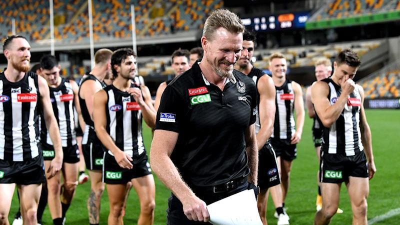 Nathan Buckley, pictured here walking off the field after a Collingwood victory.