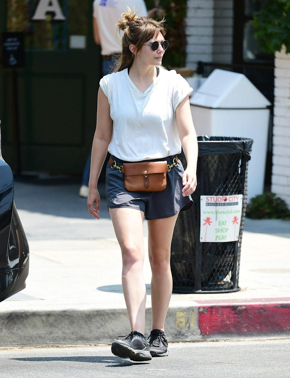 <p>Elizabeth Olsen steps out in a t-shirt, fanny pack, shorts and sneakers on July 15 in L.A.</p>