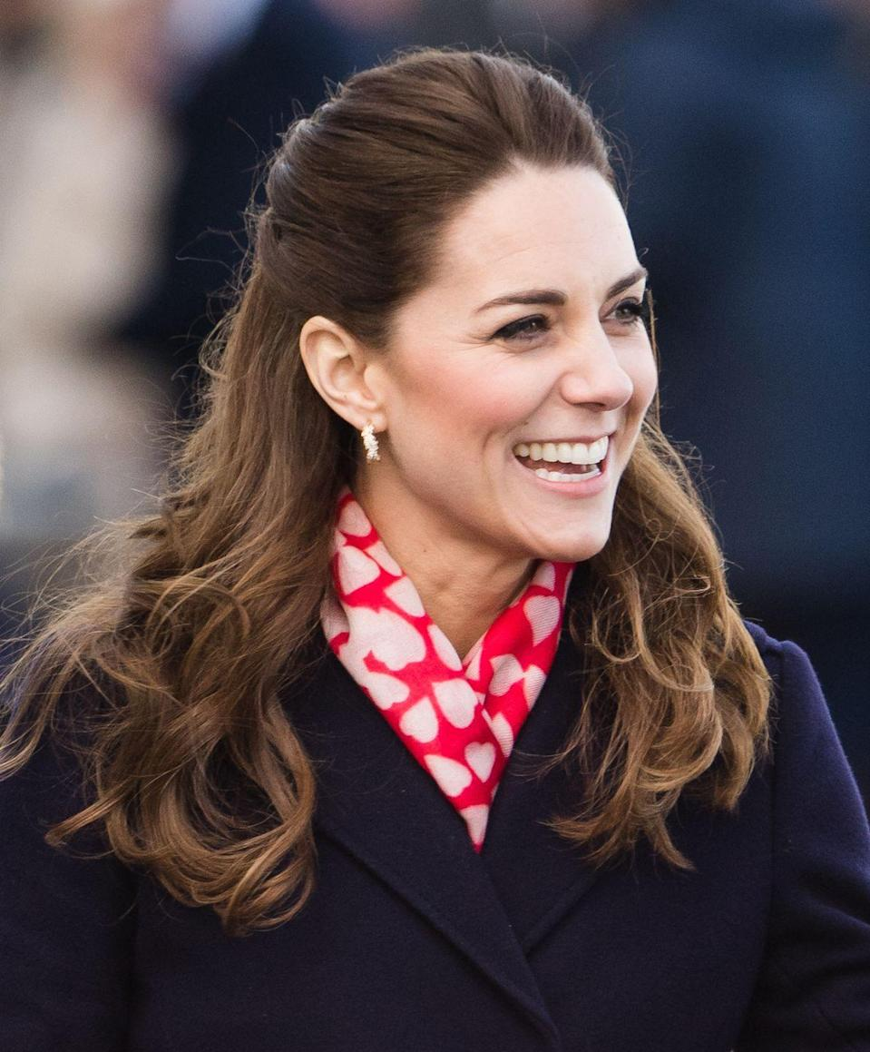 "<p>The Duchess bundled up in a red and white heart print scarf from British brand Beulah, whose mission is to eradicate slavery and help create employment opportunities for vulnerable women. (<a href=""https://www.beulahlondon.com/product/kamalaheartscarf/"" rel=""nofollow noopener"" target=""_blank"" data-ylk=""slk:Shop a similar one here"" class=""link rapid-noclick-resp"">Shop a similar one here</a>.) She sported the look on a trip to Mumbles Pier in Swansea, Wales. </p>"