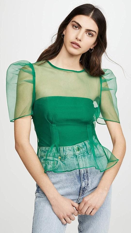 """<p>This cool <a href=""""https://www.popsugar.com/buy/Endless-Rose-Puff-Sleeve-Sheer-Top-544703?p_name=Endless%20Rose%20Puff-Sleeve%20Sheer%20Top&retailer=amazon.com&pid=544703&price=60&evar1=fab%3Aus&evar9=47160084&evar98=https%3A%2F%2Fwww.popsugar.com%2Ffashion%2Fphoto-gallery%2F47160084%2Fimage%2F47160379%2FEndless-Rose-Puff-Sleeve-Sheer-Top&list1=shopping%2Camazon%2Ceditors%20pick%2Cwinter%20fashion&prop13=api&pdata=1"""" rel=""""nofollow"""" data-shoppable-link=""""1"""" target=""""_blank"""" class=""""ga-track"""" data-ga-category=""""Related"""" data-ga-label=""""https://www.amazon.com/endless-rose-Womens-Sleeve-Sheer/dp/B0844RTS3D?s=shopbop&amp;ref_=sb_ts&amp;th=1&amp;psc=1"""" data-ga-action=""""In-Line Links"""">Endless Rose Puff-Sleeve Sheer Top</a> ($60) looks great with jeans.</p>"""