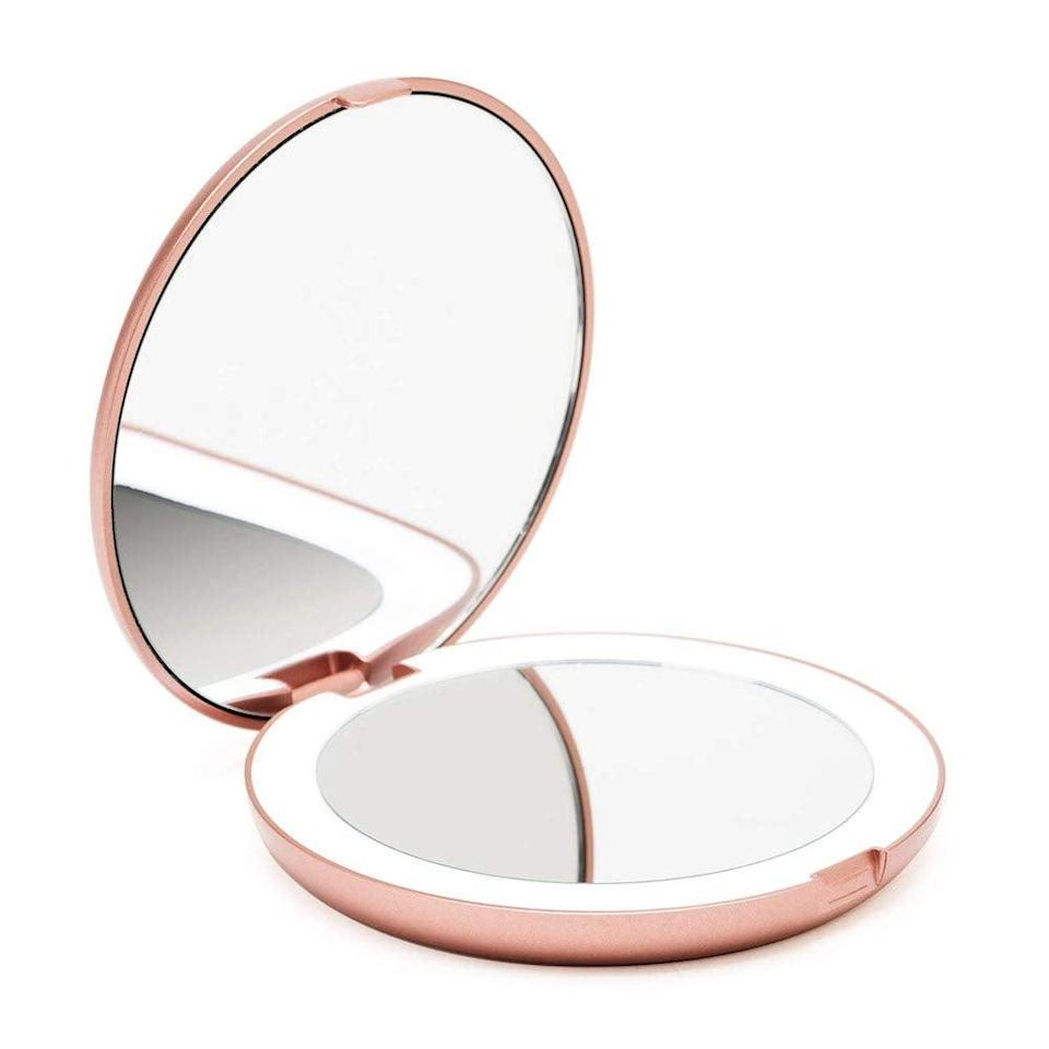 <p>Use this <span>Lighted Travel Magnifying Makeup Mirror</span> ($25) to apply makeup while you're on the go.</p>