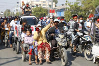 Anti-coup protesters hold a rally in Mandalay, Myanmar, Saturday, Feb. 13, 2021. Mass street demonstrations in Myanmar have entered their second week with neither protesters nor the military government they seek to unseat showing any signs of backing off from confrontations. (AP Photos)