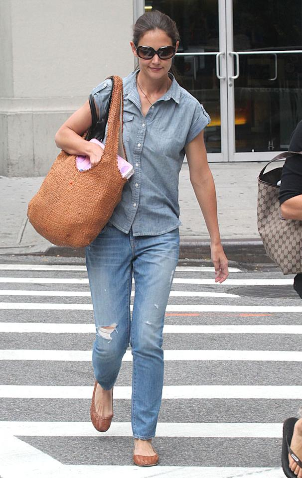 Katie Holmes mixed up her denim outfit with different washes during a stroll around New York City just four days before she filed for divorce from Tom Cruise. She may have been stressed out at the time, but she looked super comfy in her ripped jeans and denim blouse.