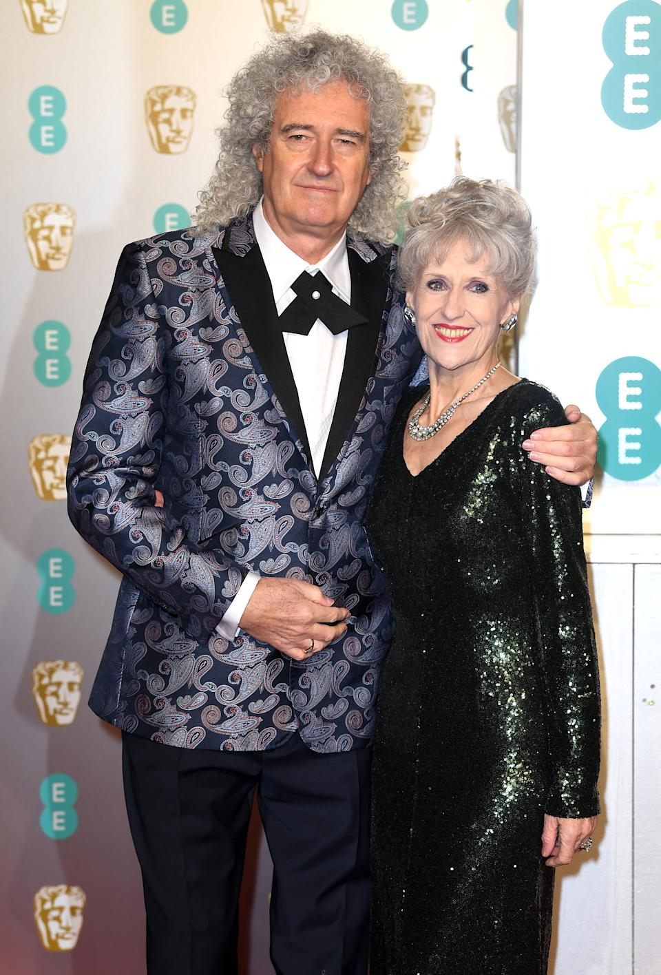 Brian May and Anita Dobson attending the 72nd British Academy Film Awards held at the Royal Albert Hall, Kensington Gore, Kensington, London