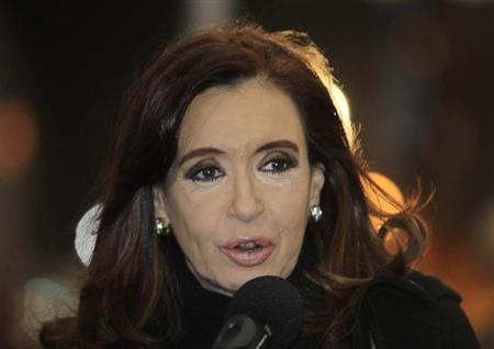 Argentina's President Cristina Fernandez de Kirchner speaks after arriving at the Silvio Pettirossi airport in Asuncion