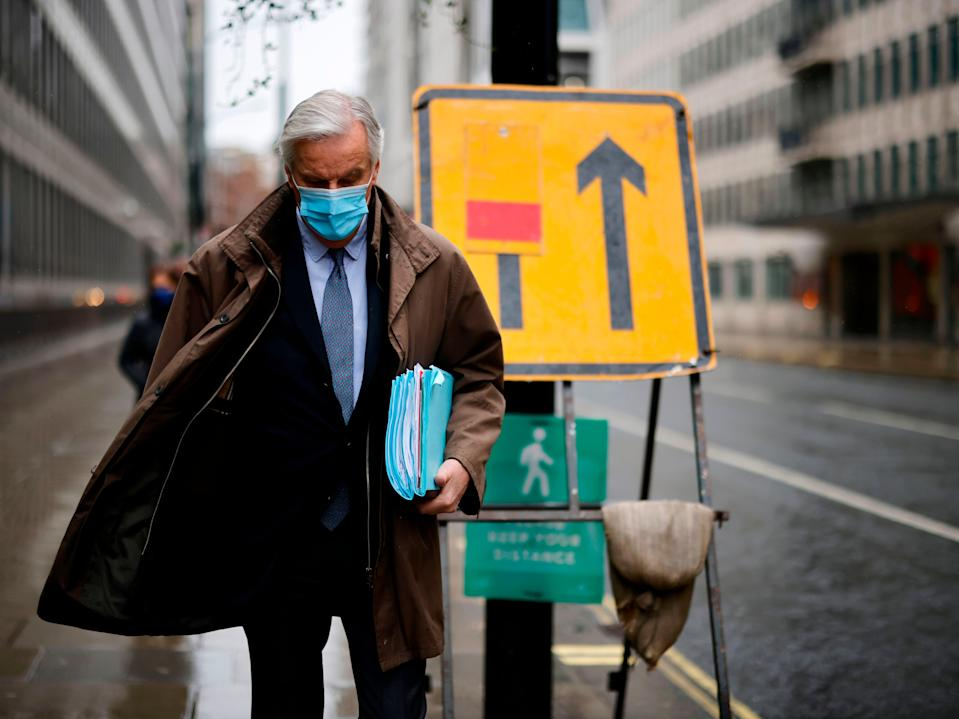 EU chief negotiator Michel Barnier walks to a conference centre in central London on Thursday for trade talks (Tolga Akmen/AFP via Getty Images)