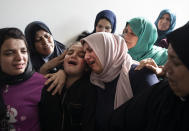 Relatives of Islamic Jihad commander, Bahaa Abu el-Atta, who was killed with his wife by an Israeli missile strike that hit their home, mourn in the family home during his funeral in Gaza City, Tuesday, Nov. 12, 2019. (AP Photo/Khalil Hamra)