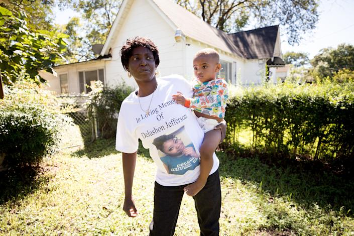 Sharon Jefferson holds her grandson, Rayray. Police say her pregnant daughter, Delashon, was fatally shot by her boyfriend in September. (Photo: Allison V. Smith for HuffPost)