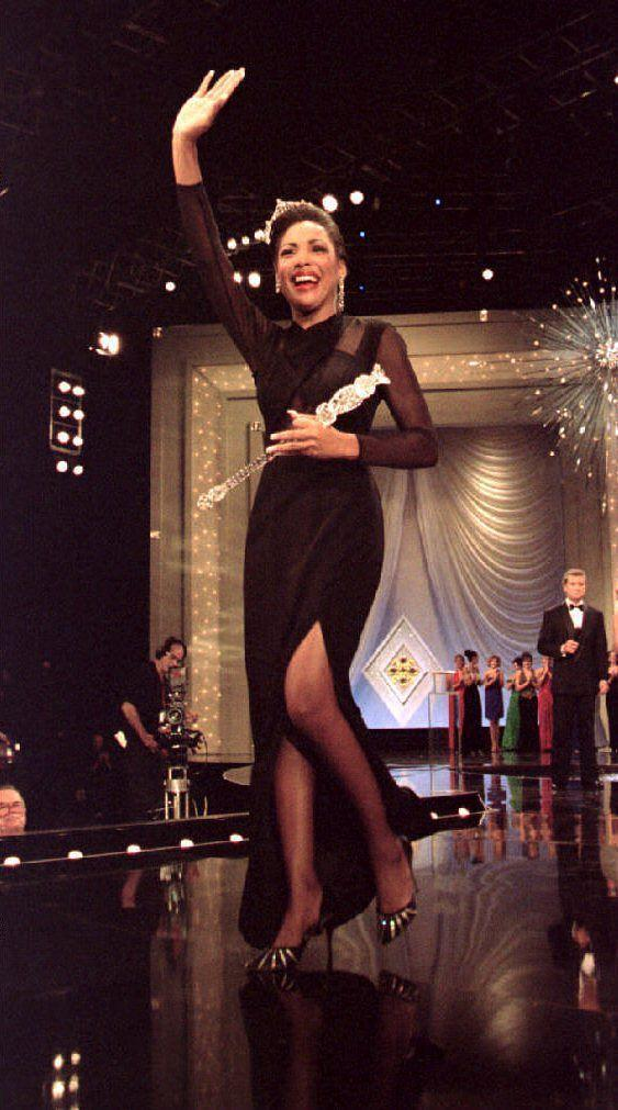 <p>South Carolina's Kimberly Aiken looked sleek and chic in a black evening gown with sheer sleeves, as she waved to her fans as the newly-titled Miss America. </p>