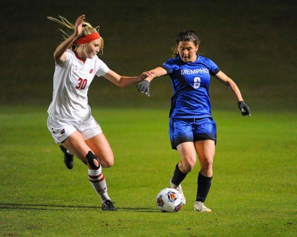 PHOTO: A Memphis midfielder and Wisconsin defender work for control of the ball, during the NCAA soccer game between the Memphis Tigers and the University of Wisconsin Badgers in Memphis, Tenn. (Kevin Langley/AP, File )
