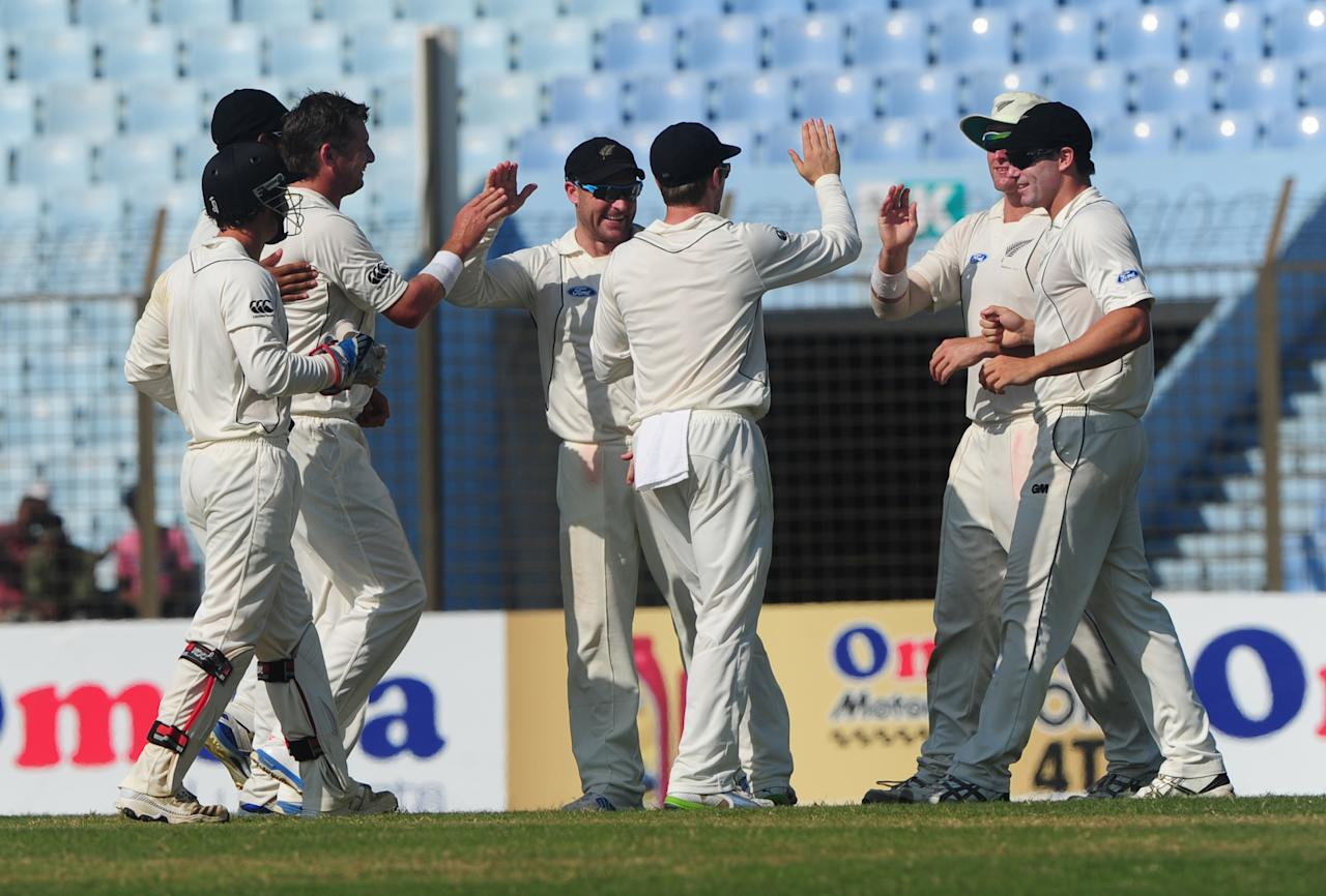 New Zealand cricketers celebrate the dismissal of Bangladeshi batsman Anamul Haque during the fifth and final day of the first cricket Test match between Bangladesh and New Zealand at The Zahur Ahmed Chowdhury Stadium in Chittagong on October 13, 2013. AFP PHOTO/Munir uz ZAMAN        (Photo credit should read MUNIR UZ ZAMAN/AFP/Getty Images)
