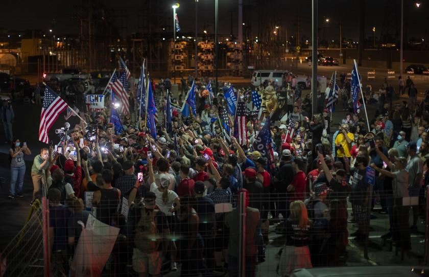PHOENIX, AZ - NOVEMBER 6, 2020: Pro-Trump supporters swarm right-wing raid host Alex Jones as he shouts conspiracy theories about the election to Trump supporters who have been protesting all day outside the Maricopa county elections building November 6, 2020 in Phoenix, Arizona. (Gina Ferazzi / Los Angeles Times)