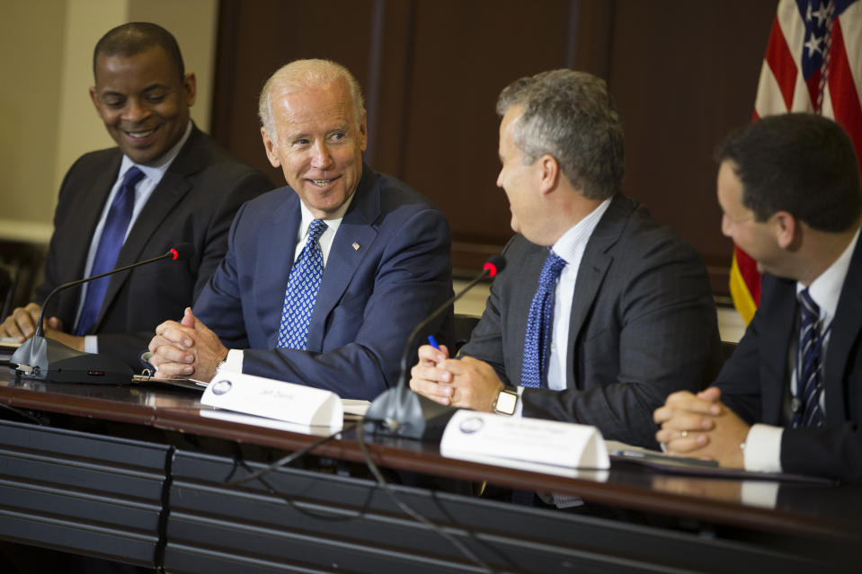 Vice President Joe Biden speaks during the White House Build America Investment Initiative roundtable, in 2015, in the Eisenhower Executive Office Building on the White House complex in Washington. From left are, Transportation Secretary Anthony Foxx, Biden, National Economic Council Director Jeff Zients, and Senior Policy Adviser at the National Economic Jake Broder-Fingert. (Evan Vucci/AP)