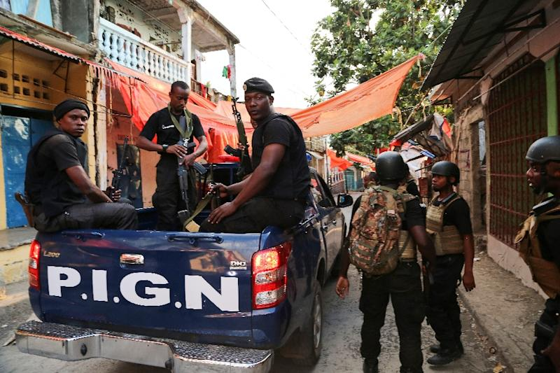 Comoros armed forces members search and patrol the medina quarter for weapons and armed men at Mutsamudu on the island of Anjouan