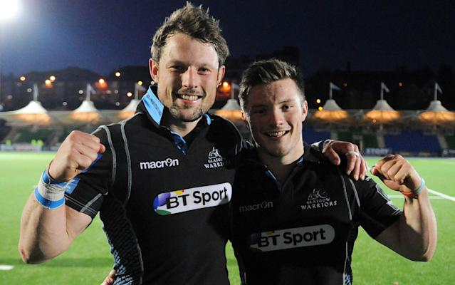 <span>Horne celebrates victory with his younger brother George</span> <span>Credit: Rex Features </span>