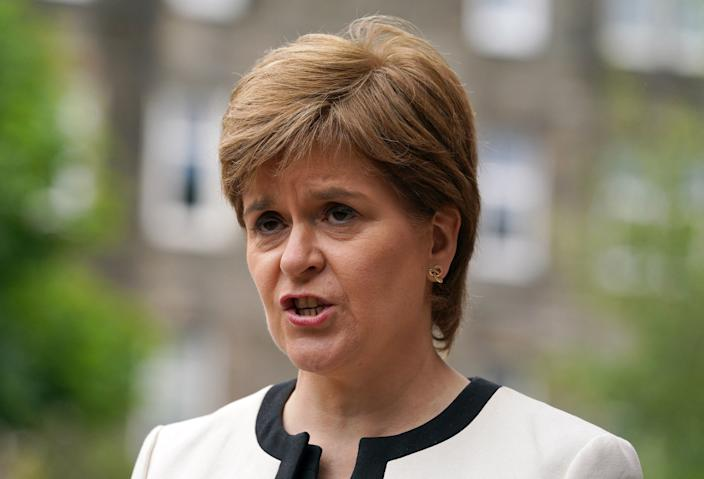 Scotland's First Minister Nicola Sturgeon speaks to the media after visiting St Margaret's House where she met EU Citizens applying for the EU Settlement Scheme on June 23, 2021 in Scotland. (Photo by Andrew Milligan / POOL / AFP) (Photo by ANDREW MILLIGAN/POOL/AFP via Getty Images)