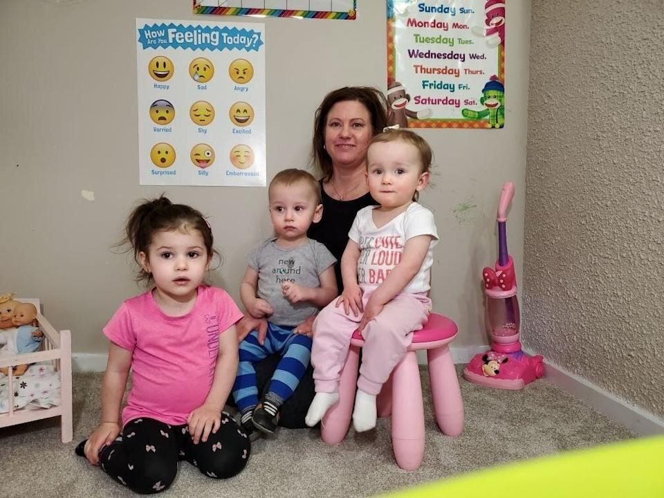 Edmonton day home provider Kim Troy is shown in a photo with some children she cares for. (The parents of the children consented to this photo being shared with HuffPost Canada). (Photo: Kim Troy)