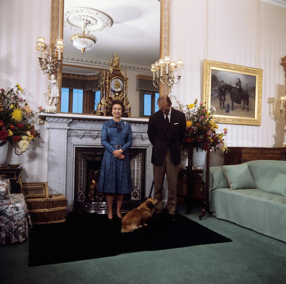 Queen Elizabeth II and the Duke of Edinburgh during their traditional summer break at Balmoral Castle. The royal couple are seen with 'Tinker', a cross between a corgi and long haired dachshund.   (Photo by PA Images via Getty Images)