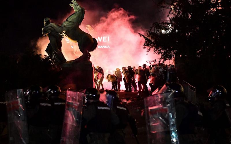 Police and protesters clash at Serbia's parliament on Friday as the Balkans face up to a renewed surge in coronavirus -  ANDREJ ISAKOVIC/AFP