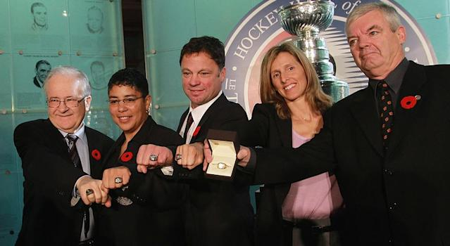 Cammi Granato (second left) became the first women ever inducted into the Hockey Hall of Fame in 2010. (Getty Images)