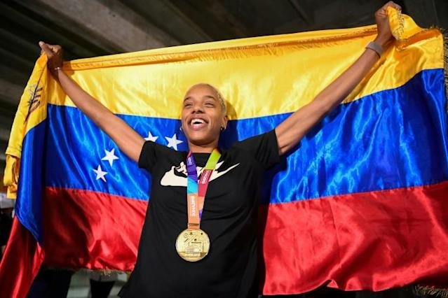 Welcome home: Yulimar Rojas arrives home after winning the 2019 world title (AFP Photo/Federico PARRA)