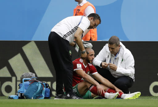 Morocco's Noureddine Amrabat is attended to after suffering an injury during the group B match between Morocco and Iran at the 2018 soccer World Cup in the St. Petersburg Stadium in St. Petersburg, Russia, Friday, June 15, 2018. (AP Photo/Andrew Medichini)