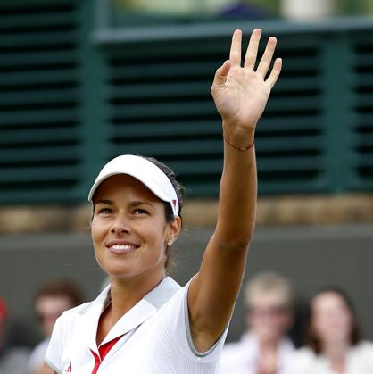 LONDON, ENGLAND - JULY 30:  Ana Ivanovic of Serbia celebrates match point during the Women's Singles Tennis match against Elena Baltacha of Great Britain on Day 3 of the London 2012 Olympic Games at the All England Lawn Tennis and Croquet Club in Wimbledon on July 30, 2012 in London, England.  (Photo by Jamie Squire/Getty Images)