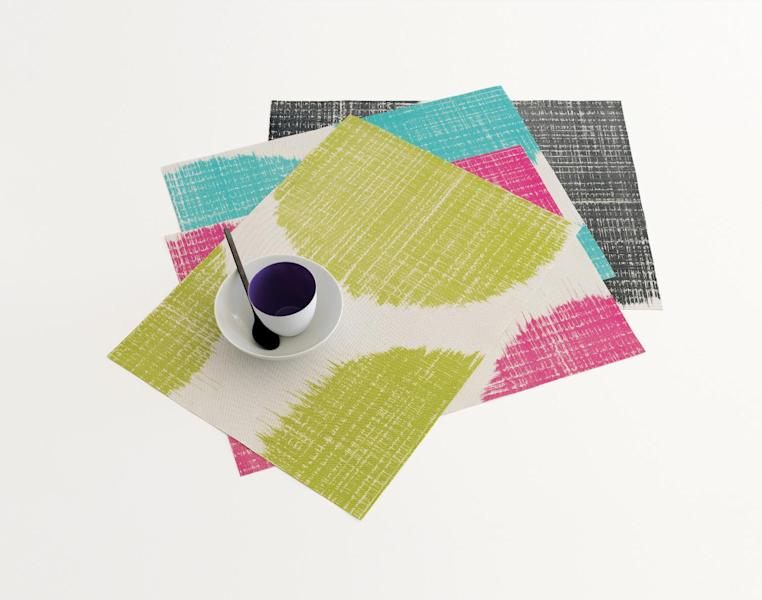 This undated publicity photo provided by Chilewich shows Sandy Chilewich's new large scale abstract Brush Dot silkscreened design on her signature woven vinyl placemat that comes in blush, green apple, pool and black (www.chilewich.com). (AP Photo/Chilewich, Victor Schrager Photography)