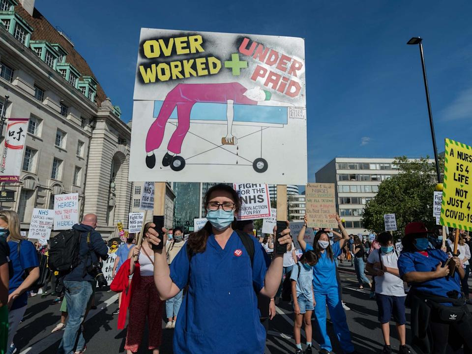 NHS staff gather outside St Thomas' Hospital to take part in a protest march to Downing Street in central London to demand pay justice for NHS and key workers: Barcroft Media via Getty Images