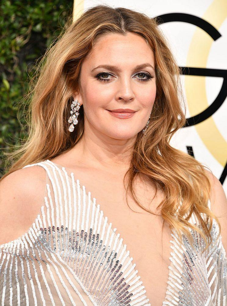 Drew Barrymore glammed up at the Golden Globes. (Photo: Getty Images)