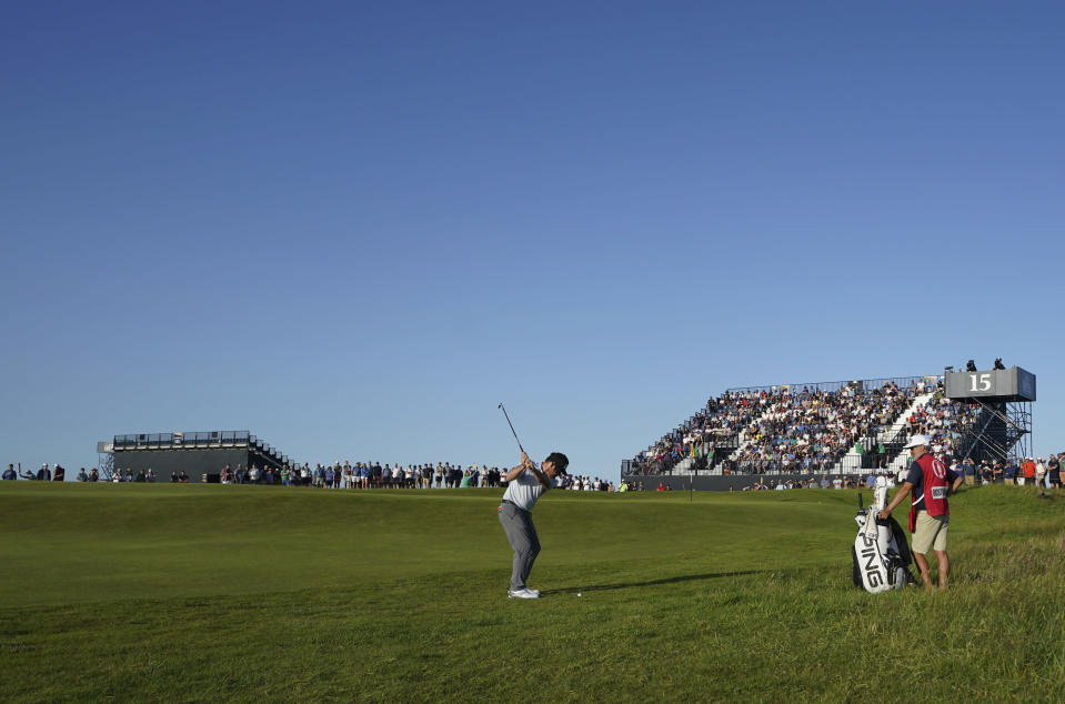 South Africa's Louis Oosthuizen goes to chip onto the 15th green during the third round of the British Open Golf Championship at Royal St George's golf course Sandwich, England, Saturday, July 17, 2021. (AP Photo)