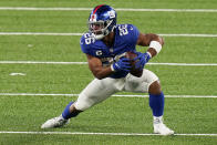 File-New York Giants running back Saquon Barkley (26) runs the ball against the Pittsburgh Steelers during the third quarter of an NFL football game Monday, Sept. 14, 2020, in East Rutherford, N.J. Barkley has had surgery to repair a torn ACL in his right knee. Giants coach Joe Judge confirmed the surgery on Saturday, Oct. 31, 2020, without giving specifics. (AP Photo/Seth Wenig, File)