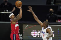 Washington Wizards guard Bradley Beal, left, shoots as Los Angeles Clippers center Serge Ibaka defends during the first half of an NBA basketball game Tuesday, Feb. 23, 2021, in Los Angeles. (AP Photo/Mark J. Terrill)