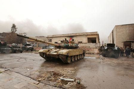 A tank of Iraqi rapid response forces is seen during clashes with Islamic State militants in Mosul