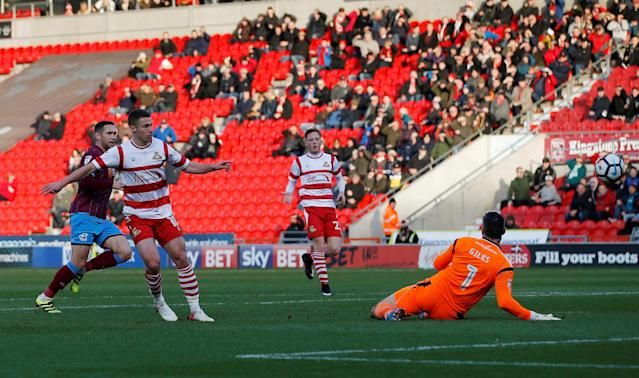 Soccer Football - FA Cup Second Round - Doncaster Rovers vs Scunthorpe United - Keepmoat Stadium, Doncaster, Britain - December 3, 2017 Doncaster Rovers' Tommy Rowe scores his sides first goal Action Images/Craig Brough