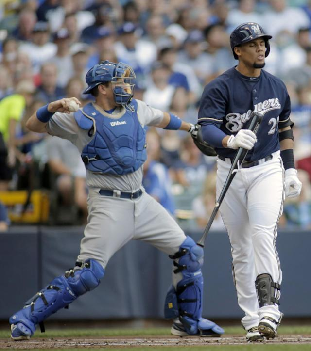 Milwaukee Brewers center fielder Carlos Gomez, right, reacts to striking out against the Los Angeles Dodgers during the first inning of a baseball game Saturday, Aug. 9, 2014, in Milwaukee. (AP Photo/Darren Hauck)