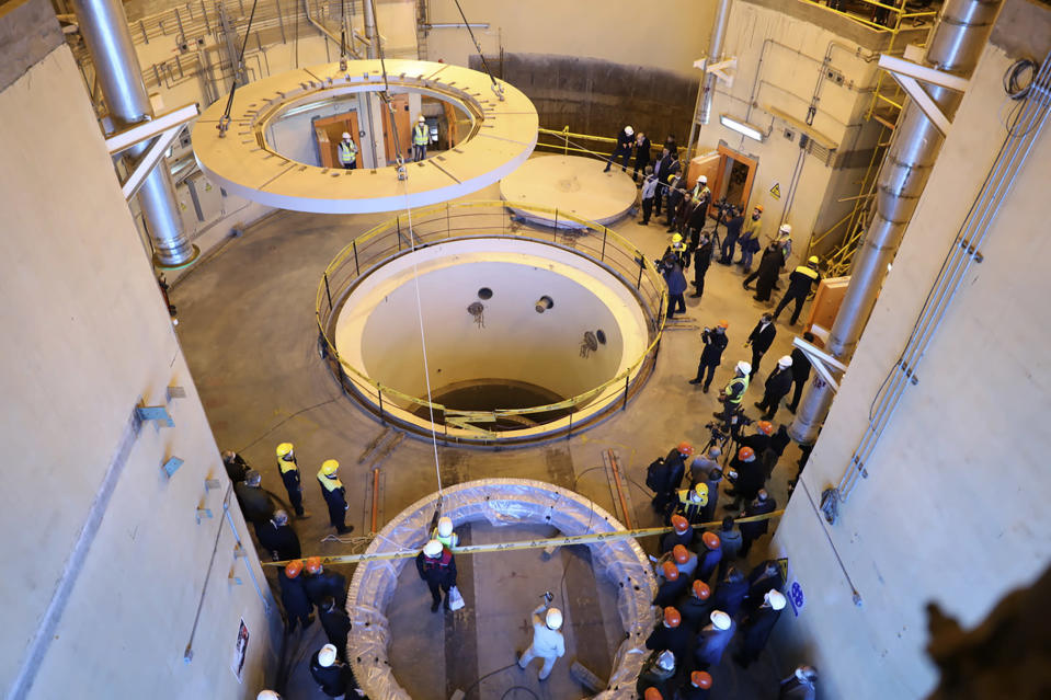 """FILE—In this Dec. 23, 2019 file photo released by the Atomic Energy Organization of Iran, technicians work at the Arak heavy water reactor's secondary circuit, as officials and media visit the site, near Arak, 150 miles (250 kilometers) southwest of the capital Tehran, Iran. In a statement after a virtual meeting on Friday, April 2, 2021, the chair of a group of high-level officials from the European Union, China, France, Germany, Russia, Britain and Iran said the participants """"emphasized their commitment to preserve the JCPOA and discussed modalities to ensure the return to its full and effective implementation."""" (Atomic Energy Organization of Iran via AP, File)"""